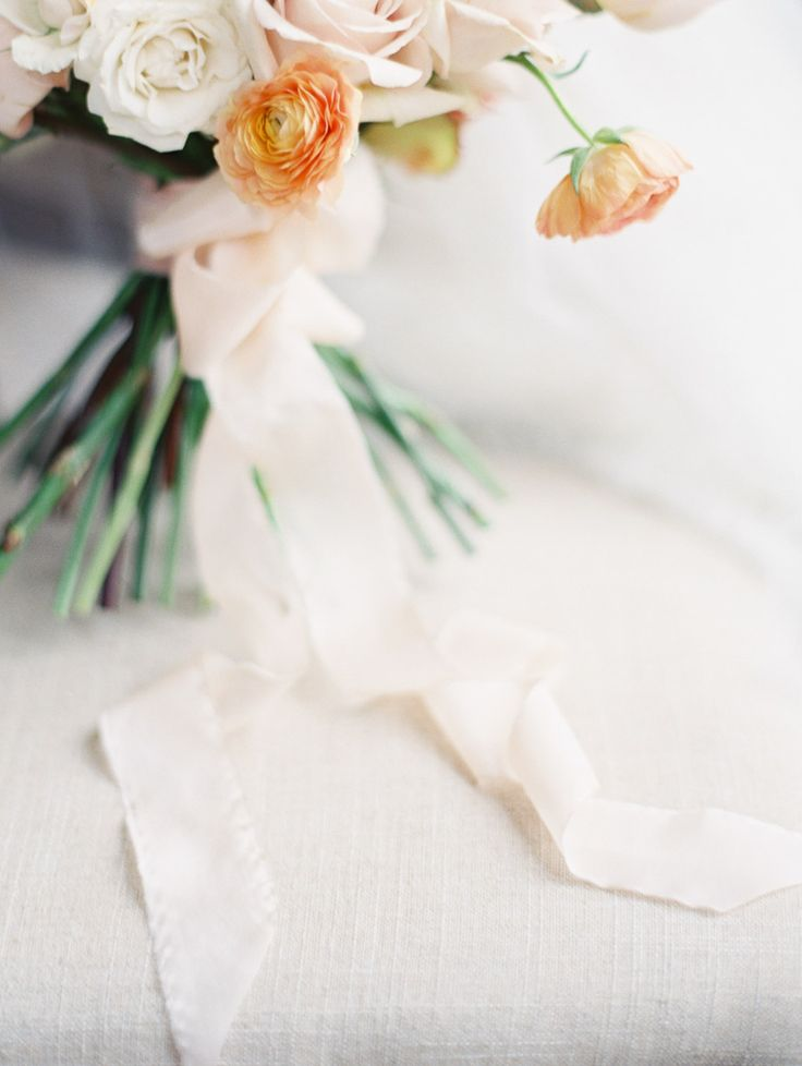 Delicate Ivory and Peach Bouquet with Silk Ribbon | Erich McVey Photography | Enchanting Autumn Woods Wedding Inspiration in Persimmon and Peach