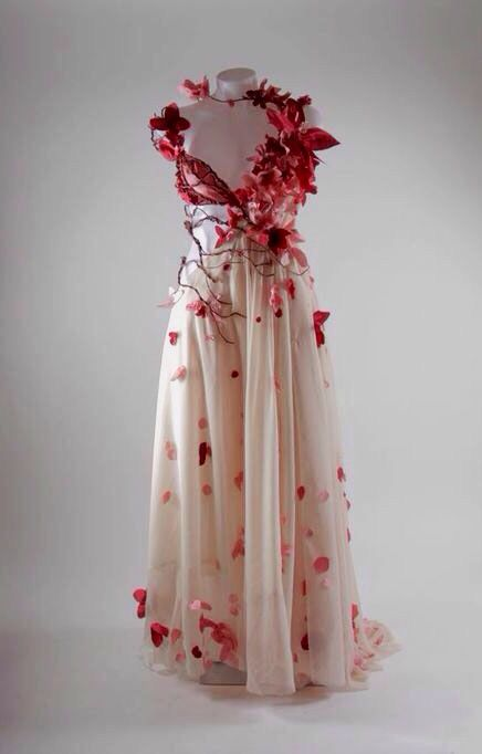 Cherry blossom with butterflies dress. I like the cascading of butterflies hovering around the right side of the garment while the other side is simply a draped chest covering the bosom. Cute, flowy piece.