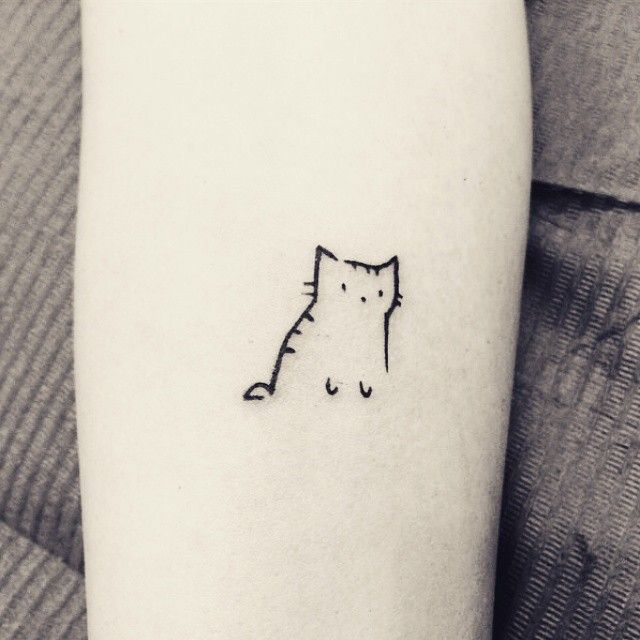 Outlined cat tattoo in black