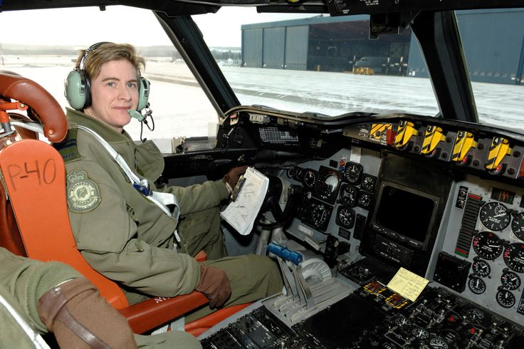 Captain (Capt) Mary Cameron-Kelly in the cockpit of the CP-140 Aurora aircraft where she reached her 5000th hour of flight in the CP-140 Aurora\Arcturus.  Capt Mary Cameron-Kelly is the first female pilot in Canadian history to fly 5000 hours in the CP-140 Aurora\Arcturus aircraft.    CF Photo by  Private Ryan Winton