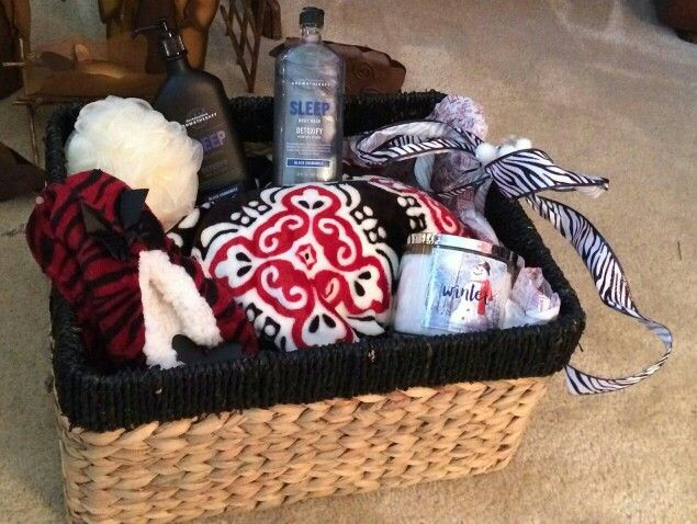 Secretary's Gift Basket full of relaxation for Christmas! Includes: super soft throw, slippers, Sleep Detoxify Body wash and lotion from Bath and Body Works, sponge and candle. All items placed in a beautiful basket and sealed in cellophane with a bow. All items have a red, black and cream theme. Beautiful!