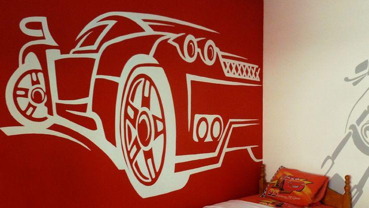 Ζωγραφική στον τοίχο σε δωμάτιο αγοριού με έντονο κόκκινο χρώμα και την αγαπημένη του Ferrari. Δείτε περισσότερες πρωτότυπες ιδέες διακόσμησης για το παιδικό δωμάτιο στη σελίδα μας  www.artease.gr