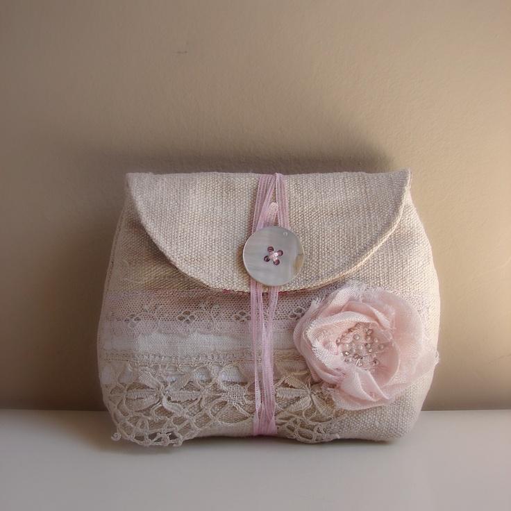 new antique linen pouches - appliqued some antique trims.... so sweet