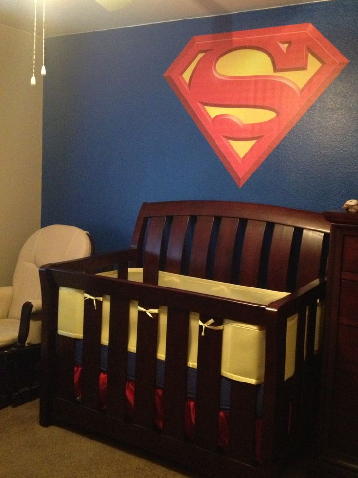 Superman Nursery - one large logo with everything else simple red blue or yellow.