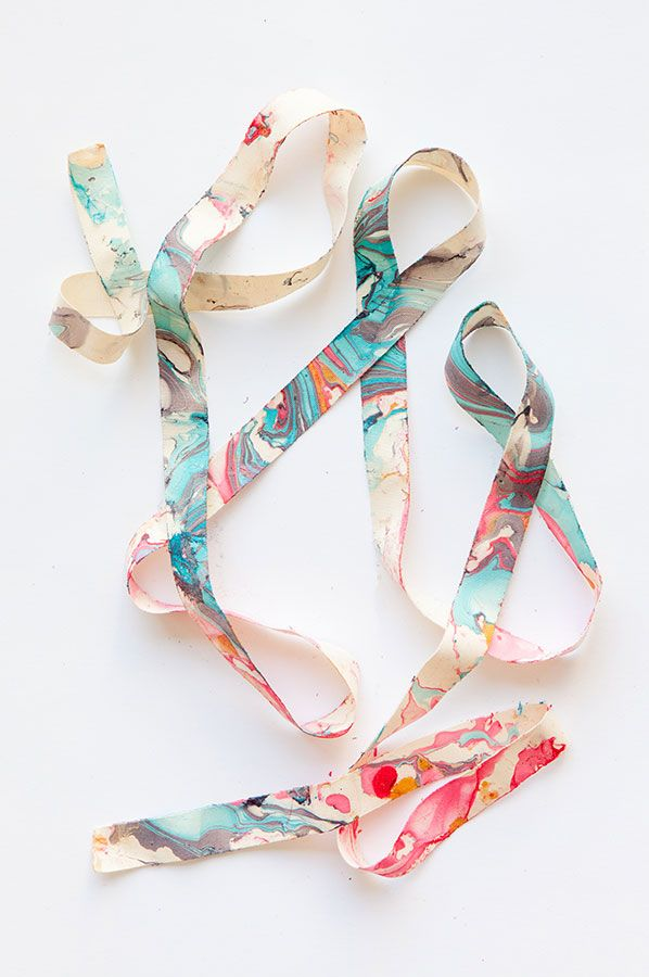 Crafting doesn't need to stop at the gift itself. This DIY marbleized ribbon is the perfect way to wrap your gift with a final pop of color. Color your own ribbon with this step-by-step tutorial by Jordan Ferney.