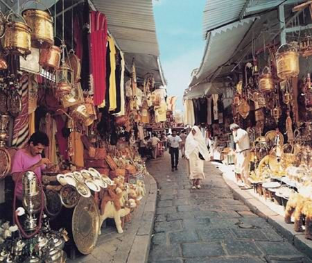 Souk. Hammamet, Tunisia. I came here and loved the many textiles and goodies. The vendors were like vultures!