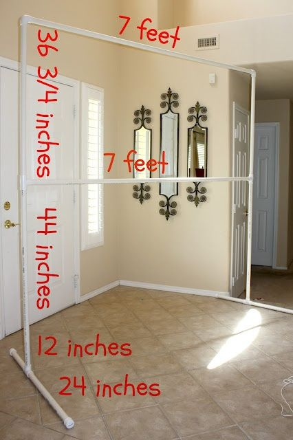 How to Make a PVC Pipe Backdrop! via @lifeinthethrifty lane with lights and tulle behind head table                                                                                                                                                                                 More