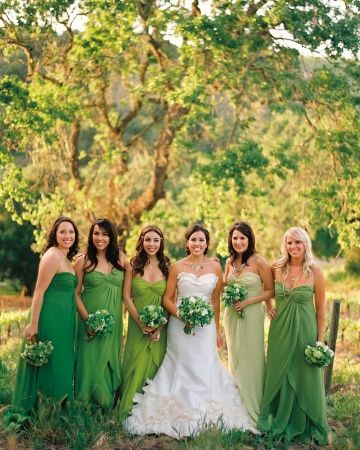 It's Easy Being Green:   At this verdant-hued fete, the bridal party donned the same Jenny Yoo dress in various shades.