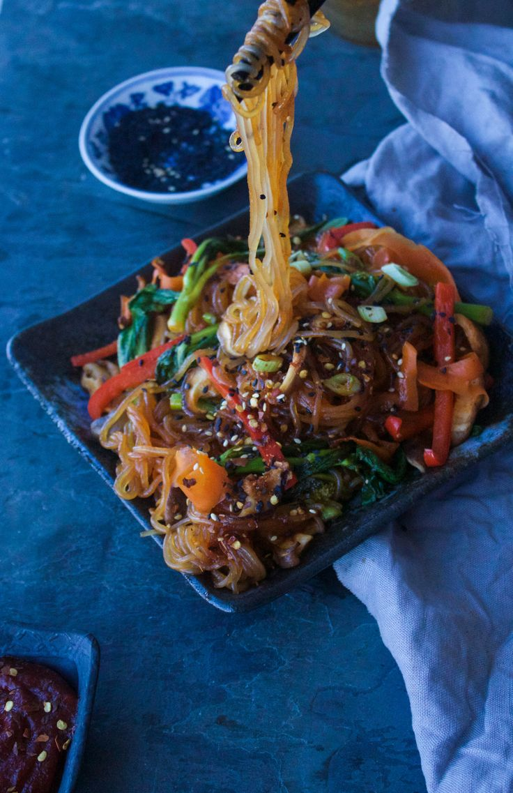 Delightful sweet potato noodles lap up spicy Korean red pepper sauce, sesame and ginger in this speedy take out-inspired stir fry.