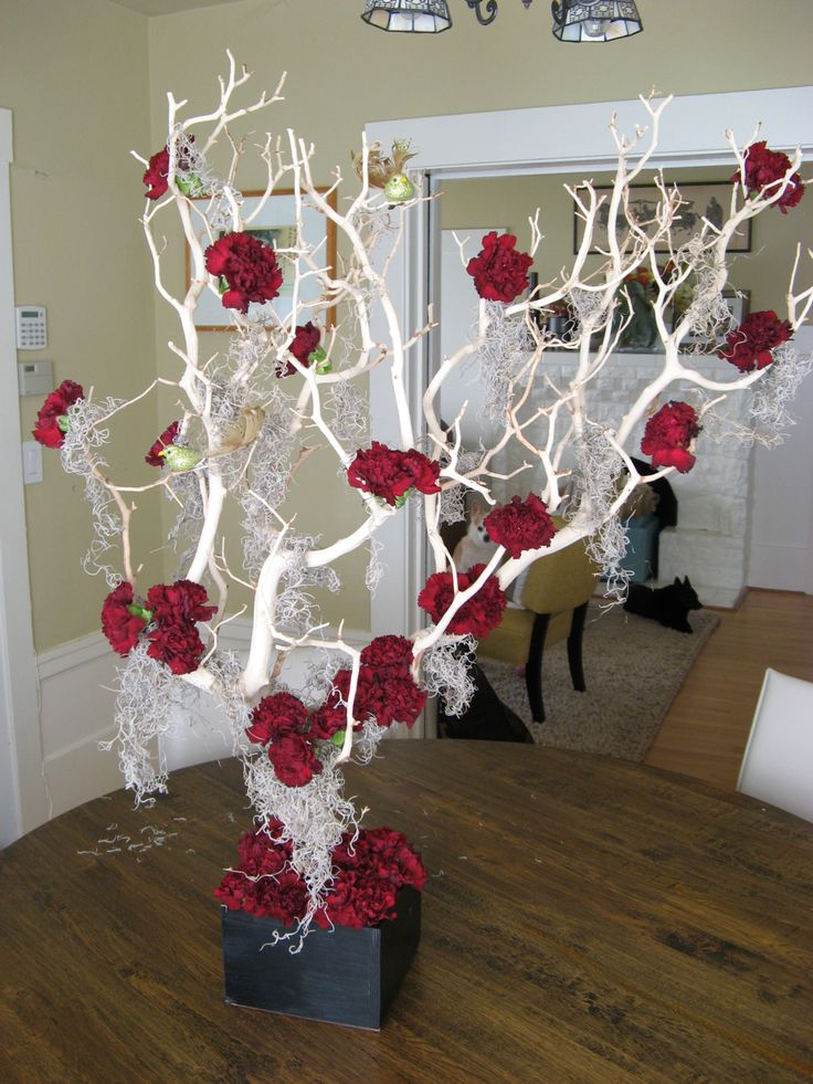 Crimson carnation and manzanita tree centerpiece tim