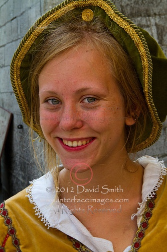 Close-up portraits of young smiling happy people in Tallinn, the capital of Estonia on the Baltic Sea. Many are dressed in medieval ethnic costumes