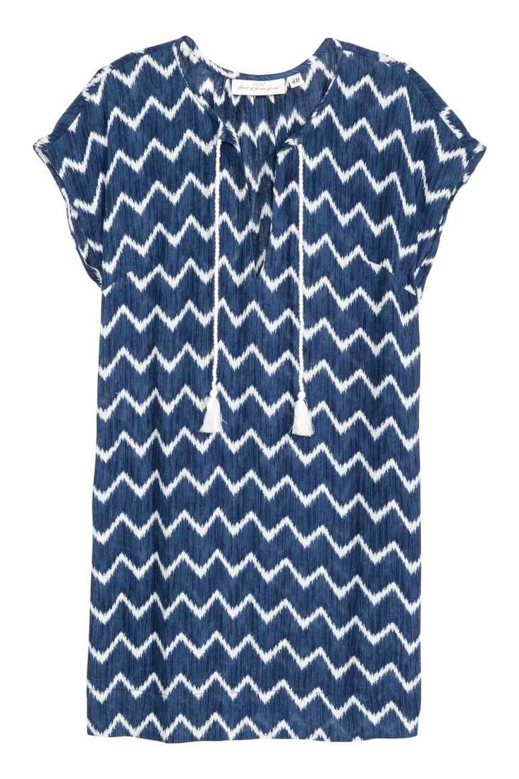 Patterned cotton dress: Short, sleeveless, straight dress in an airy, patterned cotton weave with a V-neck at the front with ties at the top and short slits in the sides.