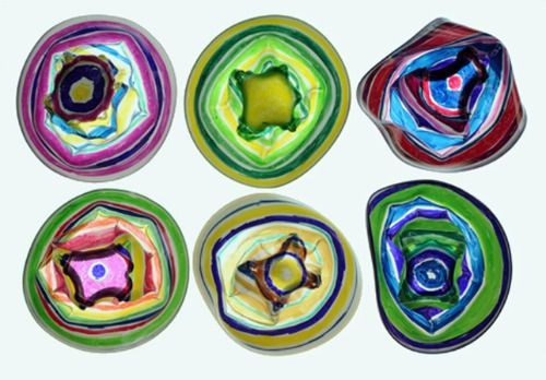 Chihuly-Inspired Cups Project... Materials: Clear plastic short solo cups & fine point sharpies Instructions: Preheat oven to 350 degrees. Place cups, right side up, on foil-lined baking pan in the oven and watch them. They will slump in about 1-2 minutes.