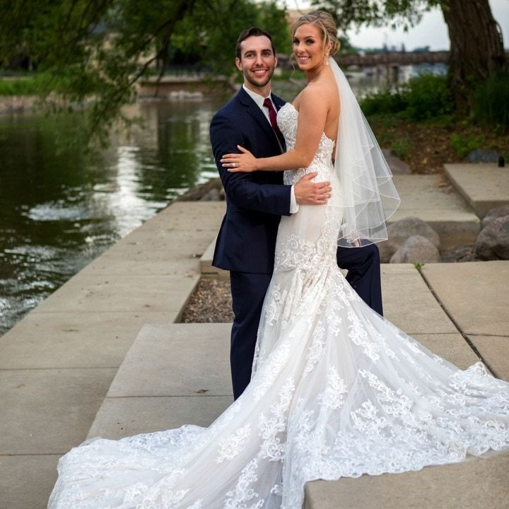Anomalie custom lace wedding dress with a fit-and-flare silhouette