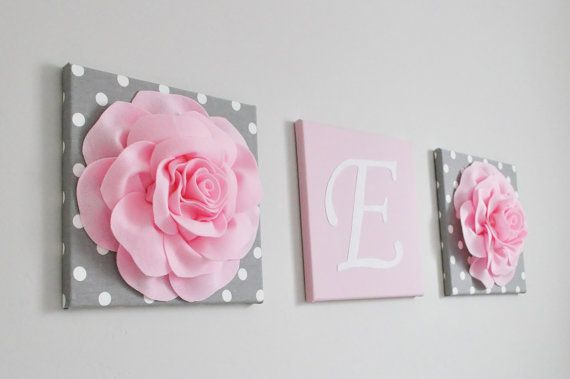 Pink and grey floral canvas and other wall art in our pink, grey and silver baby room and nursery decorating ideas post