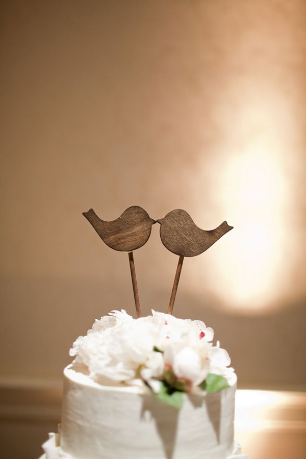 Adorable wooden bird cake topper, photo by Kellie Kano Photography | via junebugweddings.com