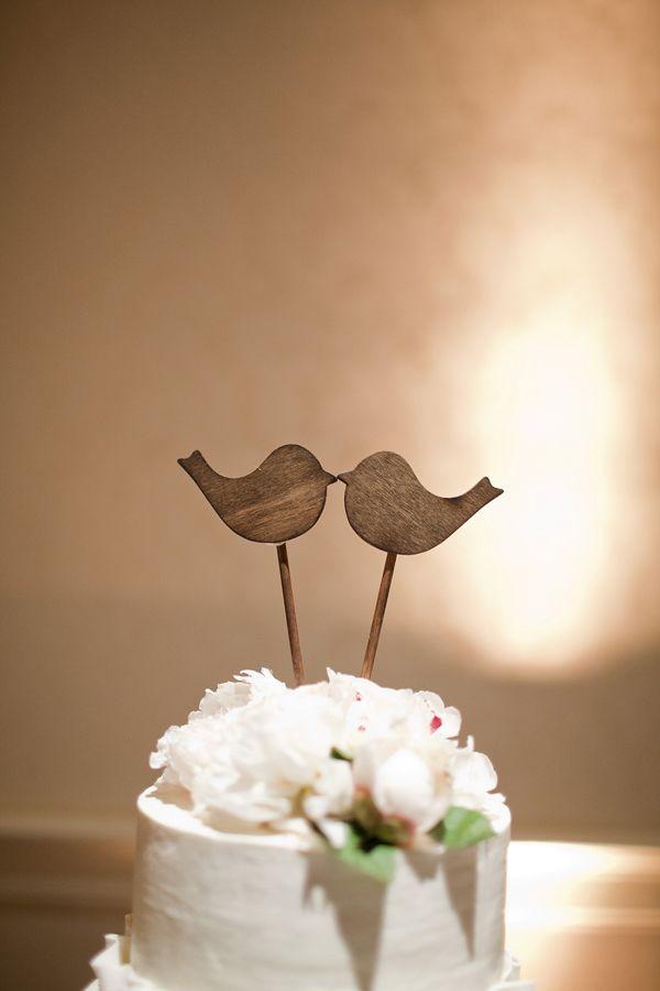 Adorable wooden bird cake topper, photo by Kellie Kano Photography | via junebugweddings.com
