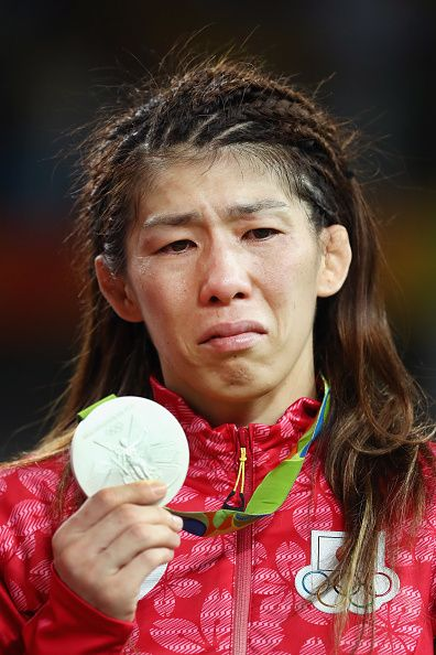 Silver medalist Saori Yoshida of Japan reacts during the medal ceremony after…