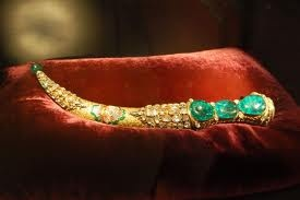 Three giant emeralds in the gold encrusted saber.This is  the prize to be stolen in a 1960's heist movie appropriately titled Topkapi.