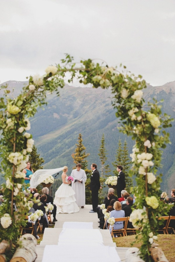 whaaaaaat. Colorado Wedding. I like the view but not that dress. maybe without the arch? like the cliff ceremony