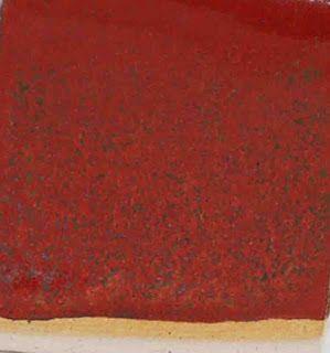 Western Pennsylvania Potters Community 163C -with controlled cooling, thicker application than above.  163 - Red Orange C/6             Minspar           47.7%  Talc                 17.2%  Bone Ash        15.3%  Flint                 11.6%  EPK                4.1%  Lithium Carb   4.1%  Crocus martis  11.5%  Bentonite        2%