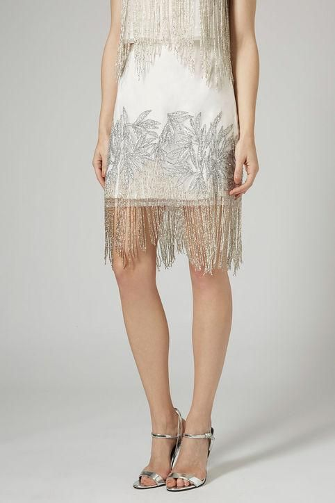 Sparkly fringe makes a party dress or skirt WAY more festive - click for more New Year's Eve outfit ideas we love!