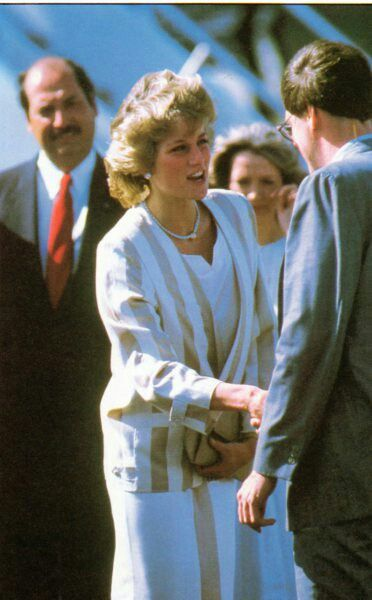 """13th November 1985, Palm Beach, Florida, USA: """"Departing from Palm Beach, Florida in November 1985 the Prince and Princess of Wales board the British VC-10 of the Queen's flight, concluding a five-day visit to the United States. The Princess wears a suit by Arabella Pollen. The jacket, in cream and coffee stripes, is made from a combination of silk and cotton. She wears a silk dress under the loose jacket"""".. Comment by Duchesseorange.."""