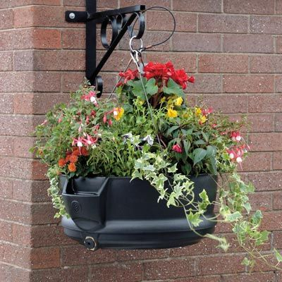 Brighten up towns and cities with the outdoor low–maintenance FullBloom™ public hanging planter. The basket is self–watering and is ideal for street lamp posts. #GlasdonUK #Planters #SelfWatering