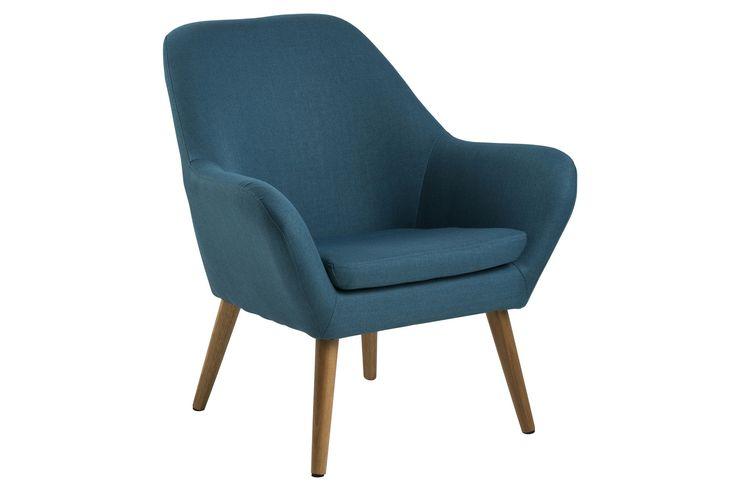 Schlicht und simpel lädt dieser petrol farbene Sessel im skandinavischen Design zum Gemütlichmachen ein.