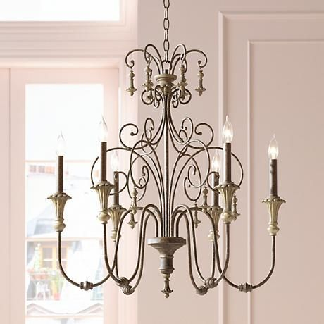 A classic shape and rich hand- finish give this bronze chandelier an elegance that will extend throughout your home.