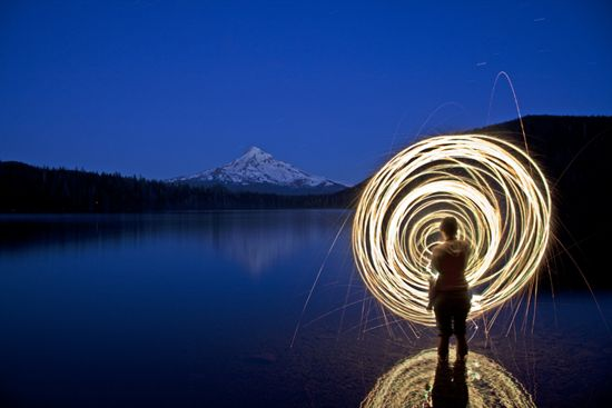 Do something like this- wave a glow stick around with a slow shutter