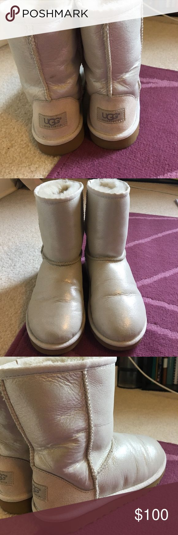White shiny authentic classic short Ugg boots Only worn twice. Like new Ugg boots. Kids size 3. Women's size 5. Tiny scuff mark on back of left shoe (shown in picture). Make me an offer!! UGG Shoes Winter & Rain Boots