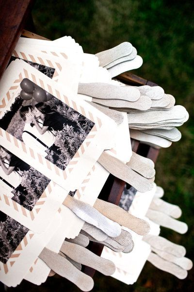 Fans that double as programs with engagement photos on the back for outdoor summer weddings.