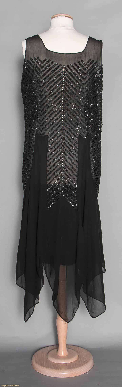 Beaded Dance Dress, Late 1920s. Black silk chiffon, handkerchief hem, rows of black beads & sequins in chevron patterns, sleeveless. Suddon-Cleaver Costume Collection (hva)
