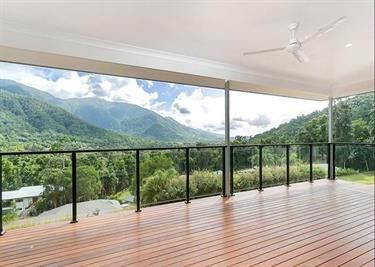 A clever use of decking to capture the views and the breeze in this sloping block in Redlynch Valley, FNQ. Custom home by Kenick Constructions.