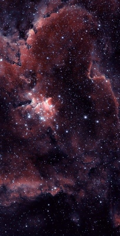 The Heart Nebula, IC 1805, Sh2-190, lies some 7500 light years away from Earth and is located in the Perseus Arm of the Galaxy in the constellation Cassiopeia. This is an emission nebula showing glowing gas and darker dust lanes. The nebula is formed by plasma of ionized hydrogen and free electrons.