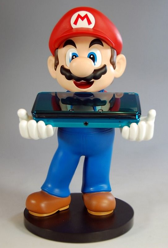 The Super Mario statuette holds your Nintendo DS, DSi or 3DS when closed ...