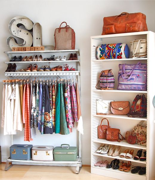 Create a rolling rack closet and use a bookcase for shoes and bags.