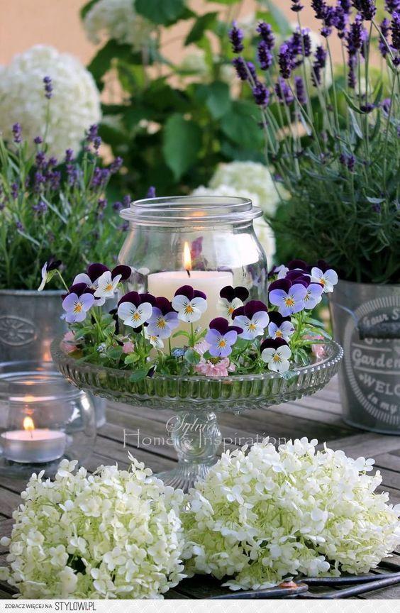 unique flower arrangement around candle