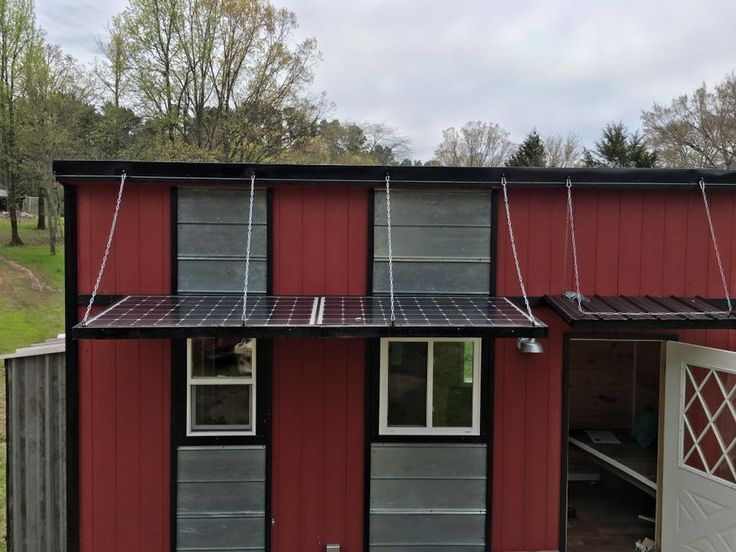SOLAR PANEL AWNING! This is an 8′ x 20′ solar tiny house on wheels for sale by Tennessee Tiny Homes. It features a metal roof, Pergo flooring, full shower, composting toilet, metal kitchen countertop, fold…