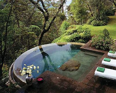 Infinity pool on a slope. Possibly a naturally filtered pool.