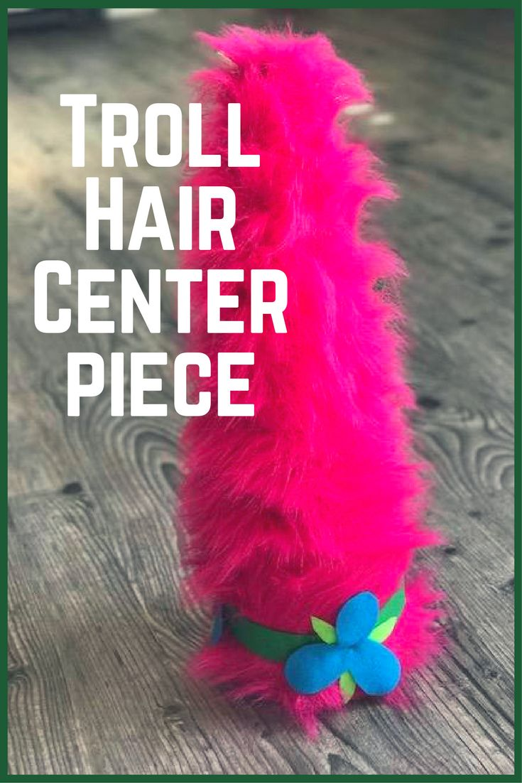 This Princess Poppy troll hair is the perfect table centerpiece for our Trolls Birthday Party. #centerpiece #trollparty #princesspoppy #ad