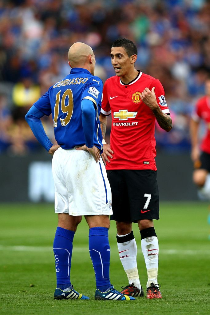 Esteban Cambiasso of Leicester City speaks with Angel di Maria of Manchester United during the Barclays Premier League match between Leicester City and Manchester United at The King Power Stadium on September 21, 2014 in Leicester, England.