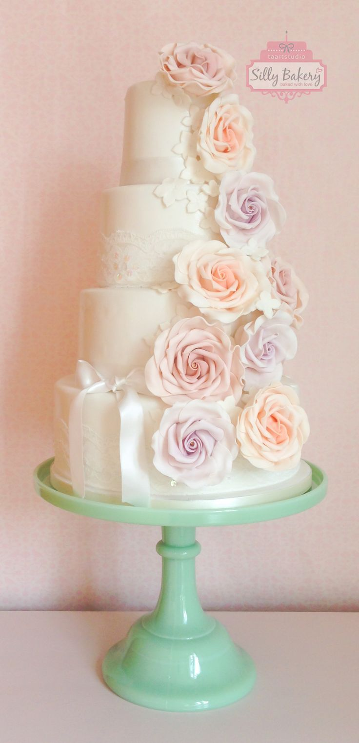 white wedding cake with pretty pastel flowers  ~  we ❤ this! moncheribridals.com