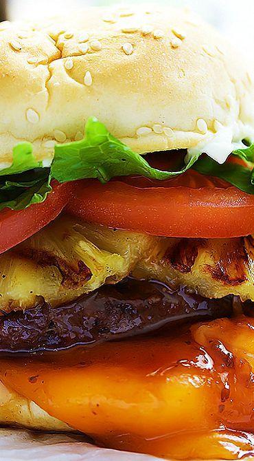 ~  1 lb. lean ground beef...salt & pepper to taste...1 c. teriyaki sauce, divided...4 slices sharp cheddar cheese...8 pineapple slices...8 tomato slices...1 c. shredded lettuce...mayo...4 burger buns with sesame seeds...teriyaki sauce...1/2 c. soy sauce...2 T. rice vinegar...1 t. sesame oil...1/4 T. honey...3/4 t. ground ginger...1 t. minced garlic
