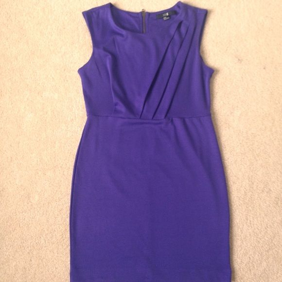Dark purple cocktail dress The color seems to be blue when light hits it but it's really a DEEP DARK PURPLE. Like the last picture. Gently used. Form fitting. I'm usually a medium and its firm fitting to me.  Gorgeous top part. Length 18.5 inches from waist on down Forever 21 Dresses Mini