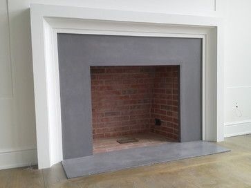 I like the cool gray surround…don't like the red firebrick.  Fireplace surrounds - transitional - Fireplace Mantels - New York - Concrete Encounter, LLC