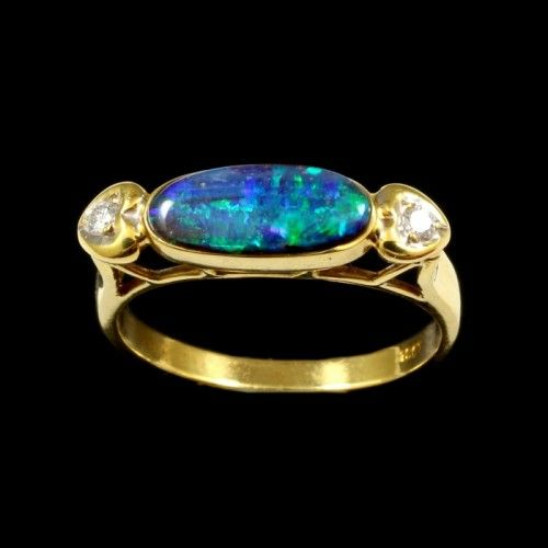Boulder Opal Ring   Field: Winton,  Queensland (Australia)  Stone Size: 11.5x5mm  Adjunct Stones: 2 diamonds  Metal: 18k yellow gold  Finger Size: U.S: 7 1/2 U.K: O  Go hereto find finger size  For different countries  Shipping: Free  Packaging: Gem pouch  Guarantee:International  References:testimonials  Questions? contact ushere  Member: American Opal Society.  Arrival time: Usually between one and two weeks by registered international post   Ring Varieties There are mult...