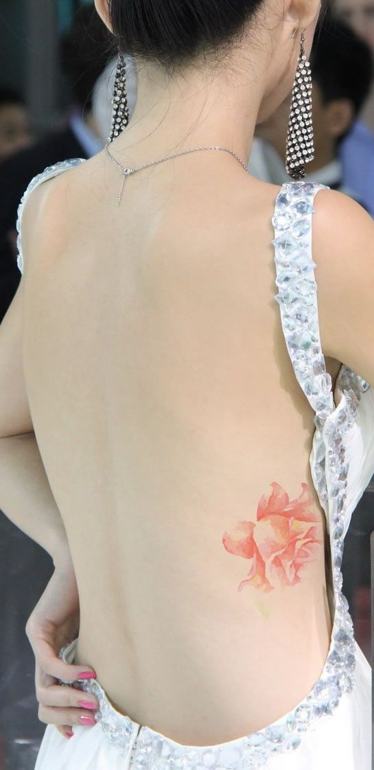 Beautiful Rose Tattoo the water paint effect looks stunning on her beautiful pale skin. Delicate, exotic and gorgeous.