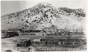 Trees on Tenderfoot Mountain are alive and well when this photograph was taken March 20, 1895. They began dying shortly after the smelter opened – upwind – in 1902, and by 1917 there were almost none left. Two foot paths up the mountain were used by hundreds of visitors who wanted to get a view of the city while they waited to change trains. The mountain was a favorite picnic spot for locals as well.